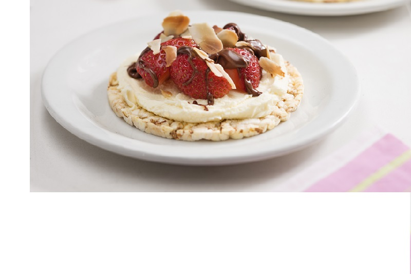 Delicious sweet snack or dessert of chocolate spread (Nutella) fresh strawberries, mascarpone & sliced roast almonds