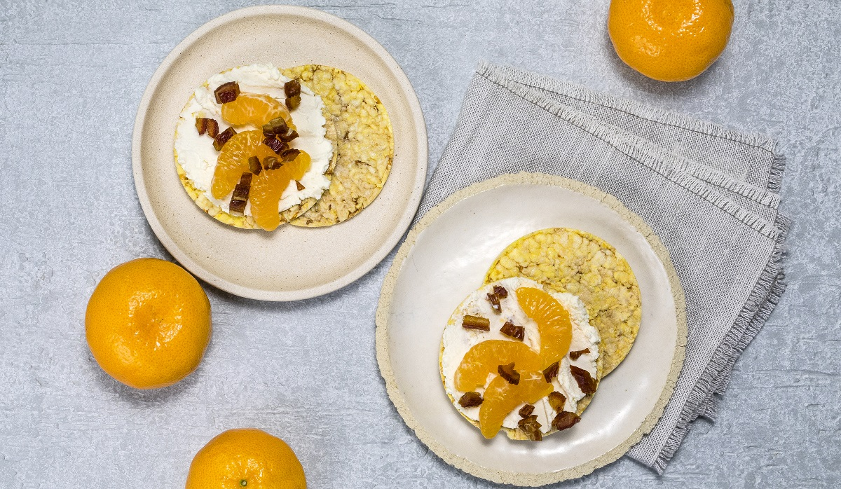 Ricotta, Mandarin, & chopped dates on CORN THINS slices