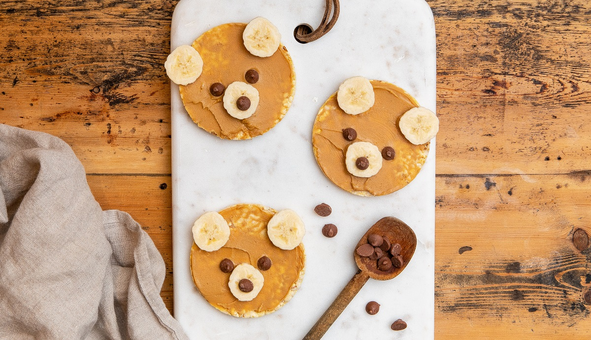 Teddy Bear Faces - Corn Thins slices, peanut butter, banana & choc chips