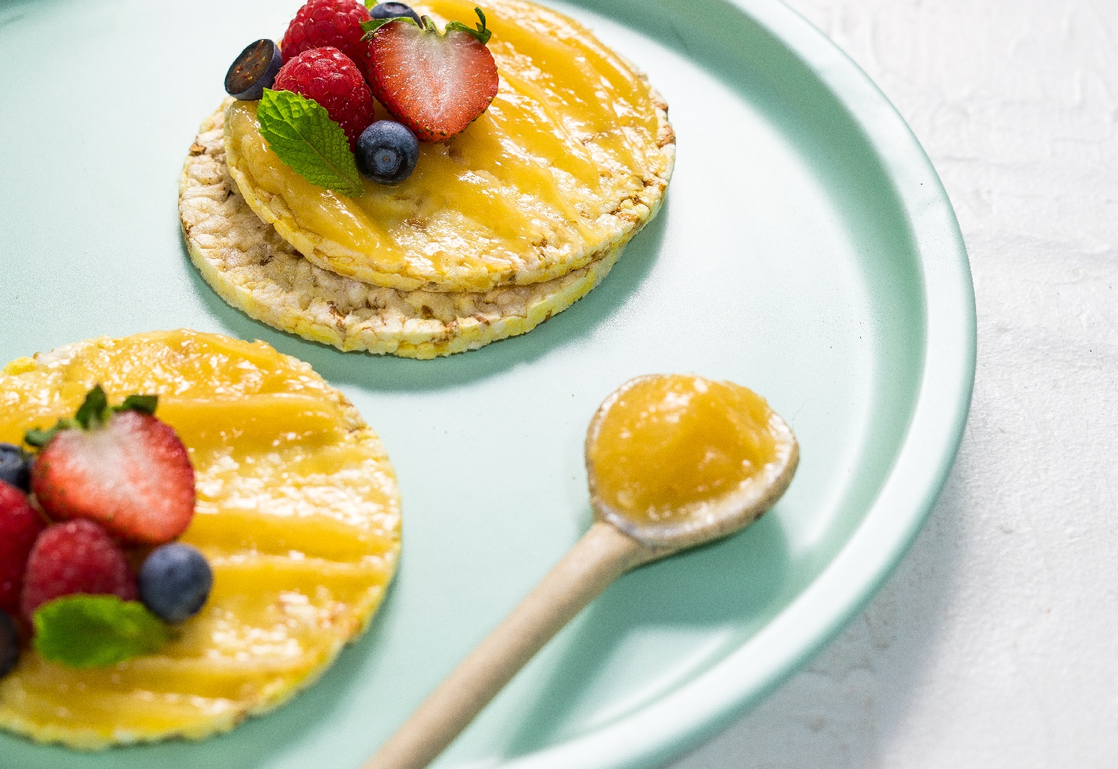 Lemon Curd, berries & mint on CORN THINS slices as a snack