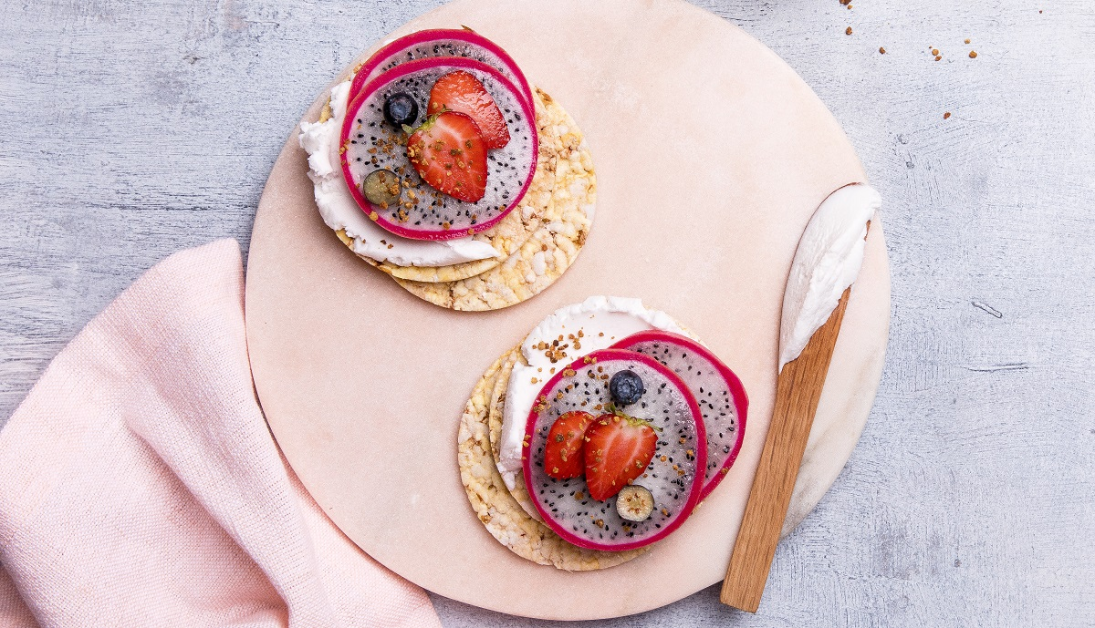 Great snack idea of dragon fruit, coconut yoghurt, strawberries & blueberries on CORN THINS slices