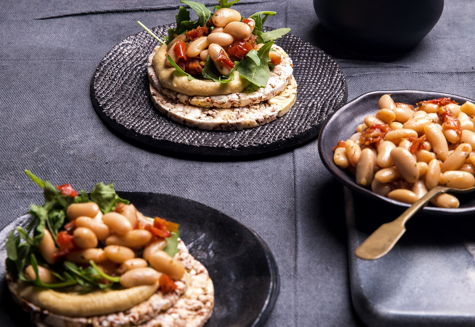 Hommus, Rocket, White Beans & Sundried Tomatoes on CORN THINS slices