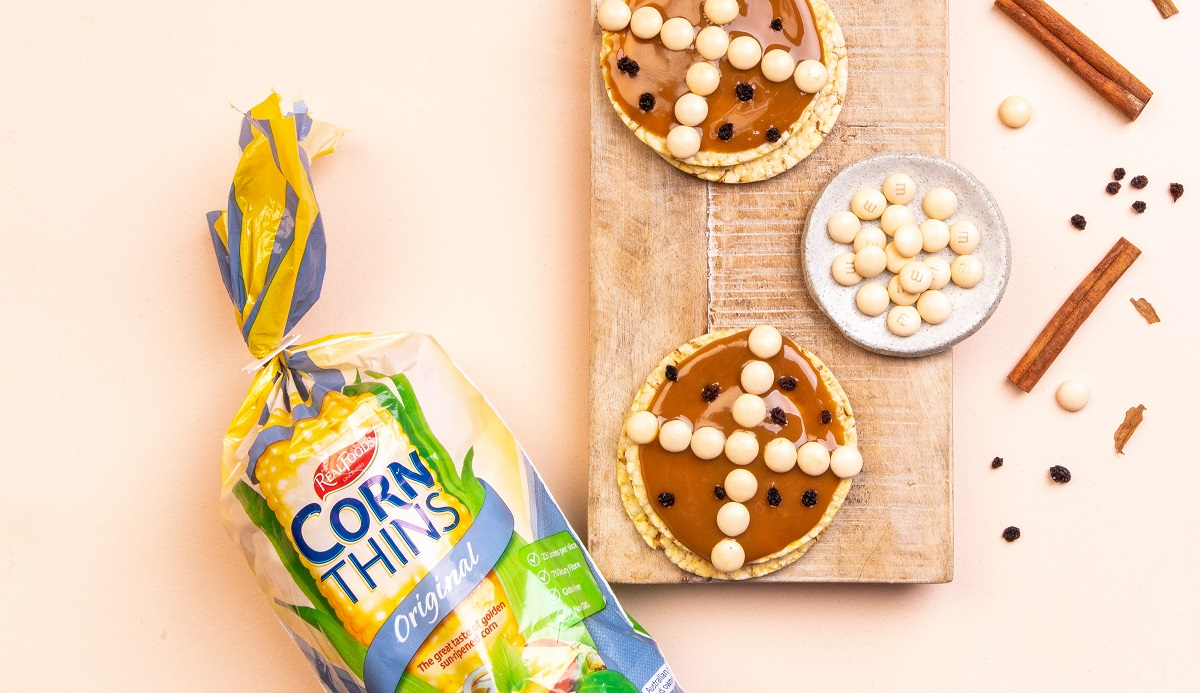 Easter treat using CORN THINS slices - caramel spread, m&m's & currants