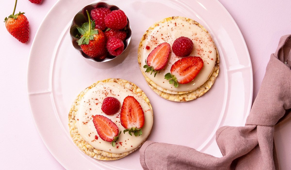 White chocolate, raspberries & strawberries on CORN THINS slices. A decadent treat