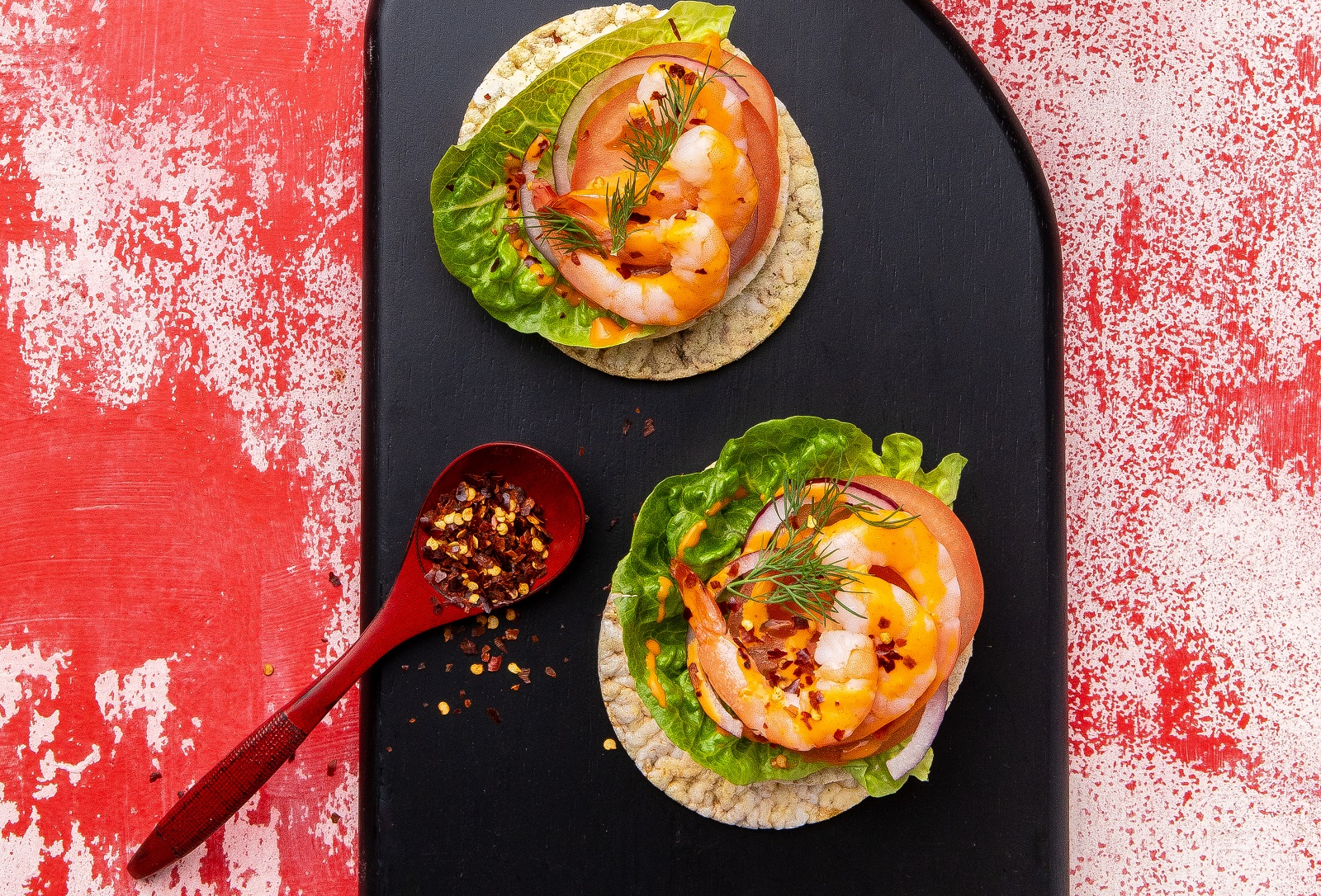 Prawns, Sriracha Mayo, Red Onion, Lettuce & Chilli Flakes on CORN THINS slices