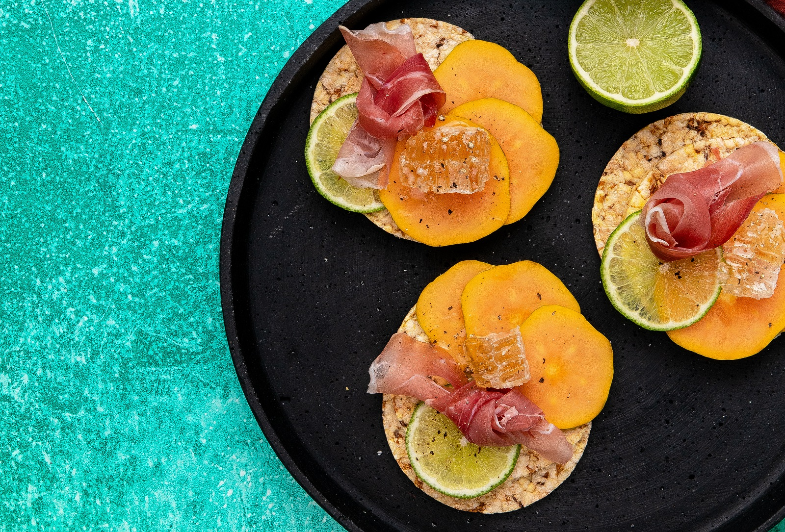 Papaya, Prosciutto, Honey & Lime on Corn Thins slices