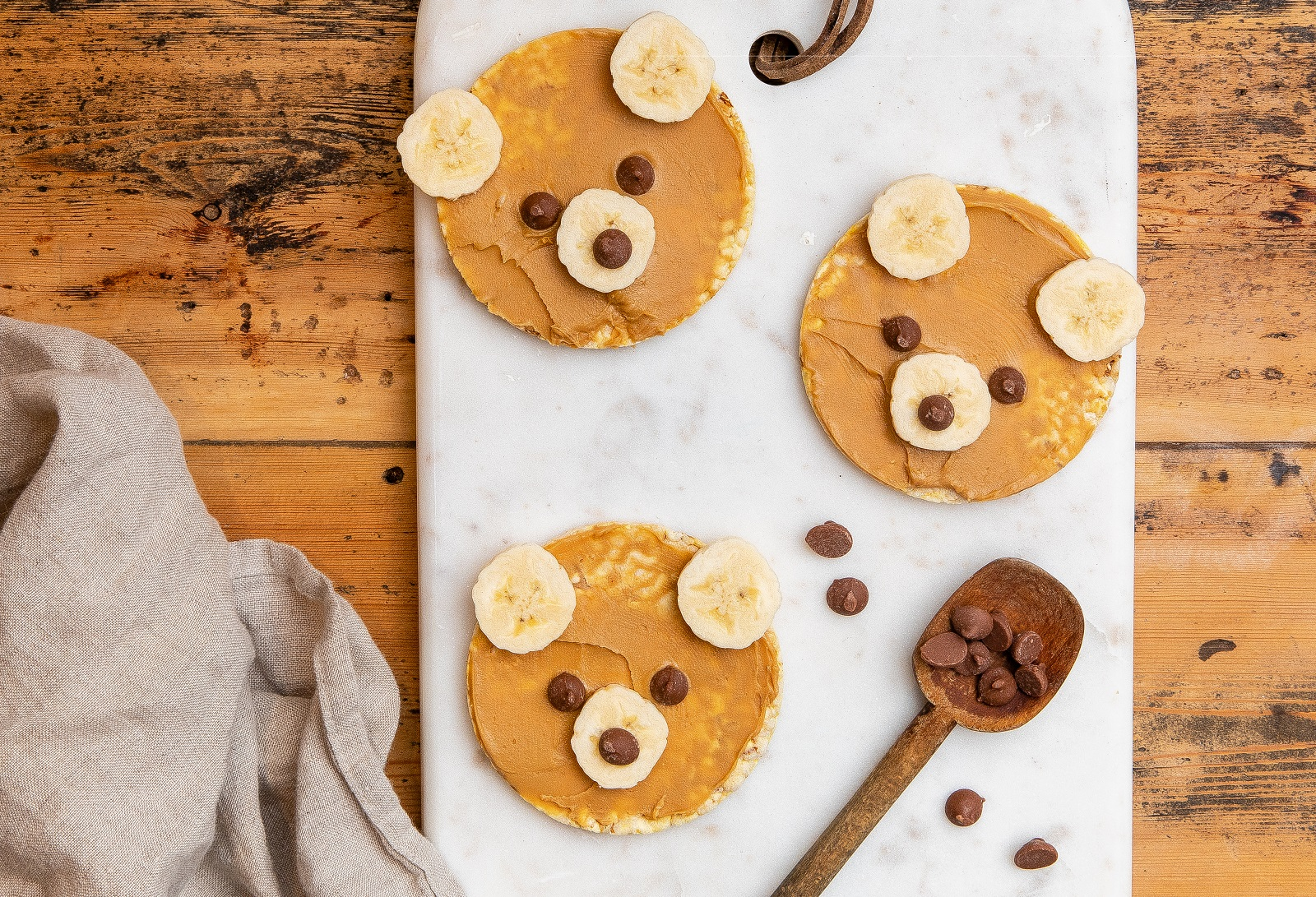 Fun Teddy Bears made from CORN THINS slices, banana, choc chips & nut butter