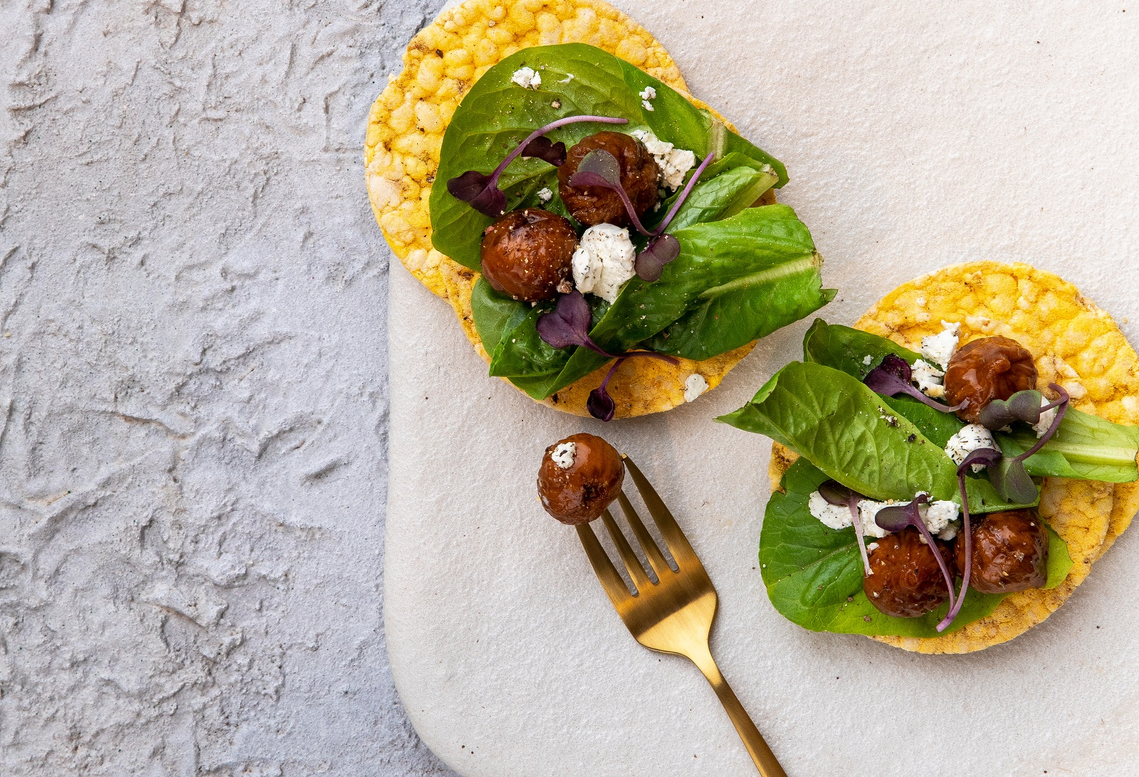 Marinated Baby Fig, Salad & Goats Cheese on CORN THINS slices