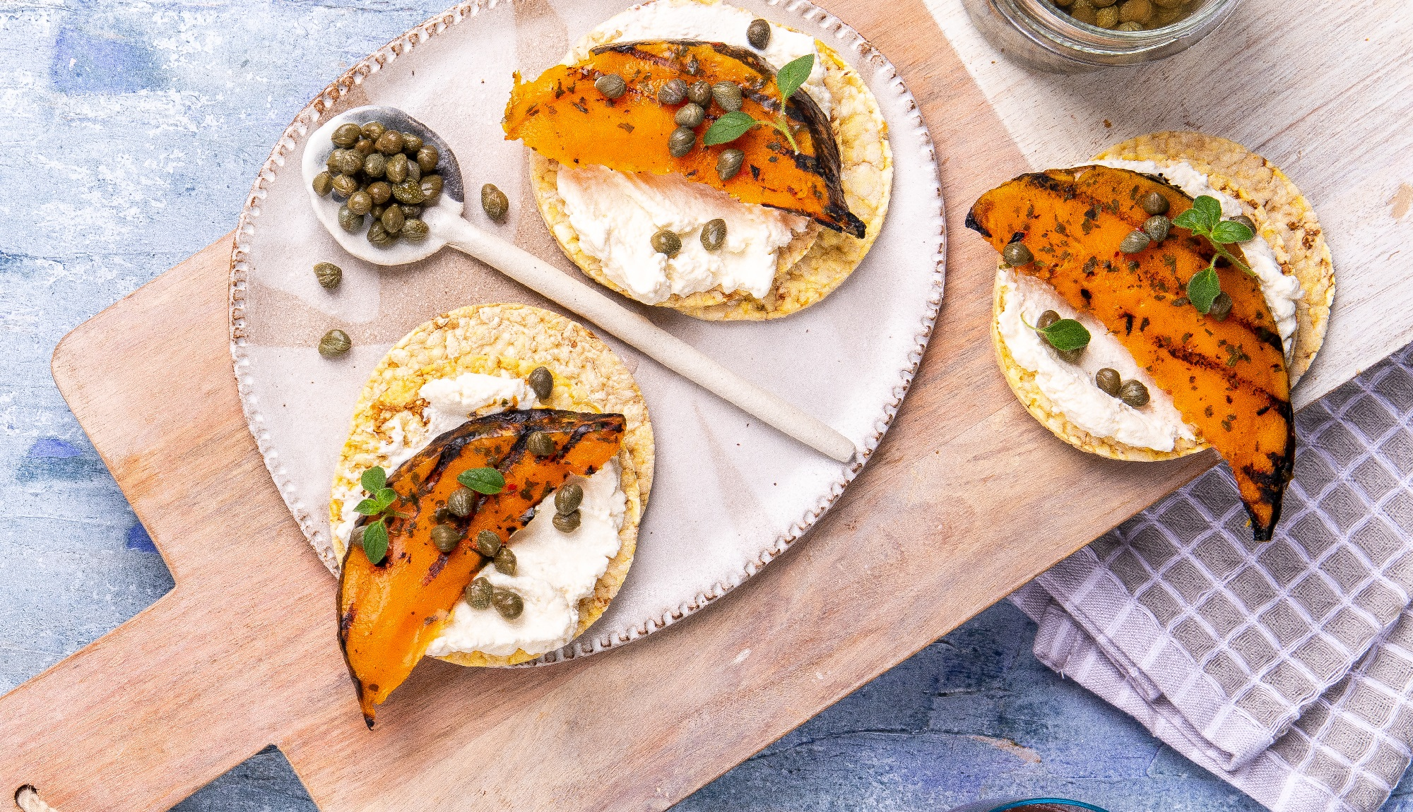 Ricotta, roast pumpkin & capers on Corn Thins slices for lunch